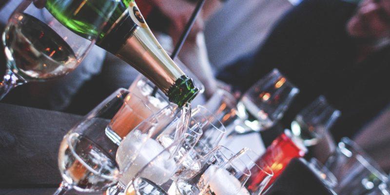 pouring-a-bottle-of-champagne-picjumbo-com-ilovepdf-compressed